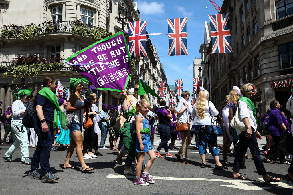 Women take part in mass participation artwork 'Processions' to celebrate one hundred years of votes for women