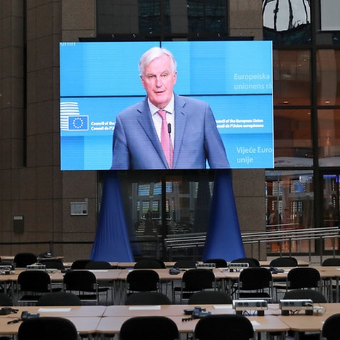 A big screen placed in the main press EU summit hall displays European Union Brexit negotiator Michel Barnier