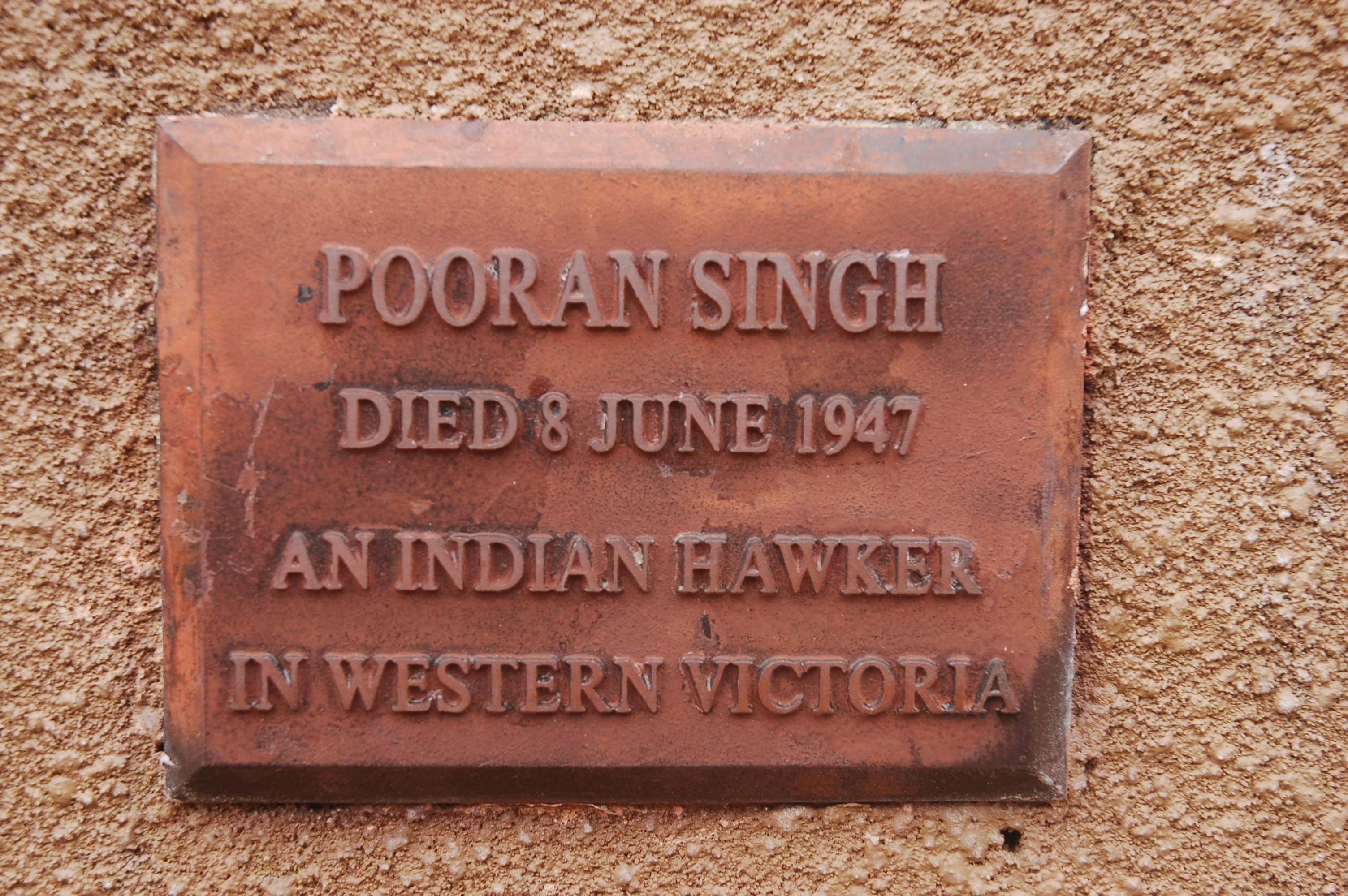 A plaque at the niche at Warrnambool cemetery that remained home to Pooran's ashes for decades