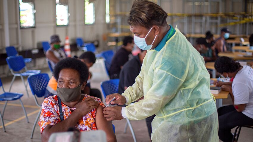 A health worker gives a dose of AstraZeneca to a Fiji resident at a vaccination centre in Suva.