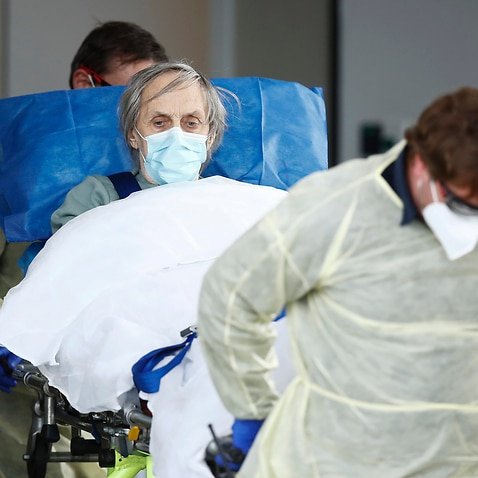 A resident is taken away in an ambulance from Epping Gardens Aged Care Facility.