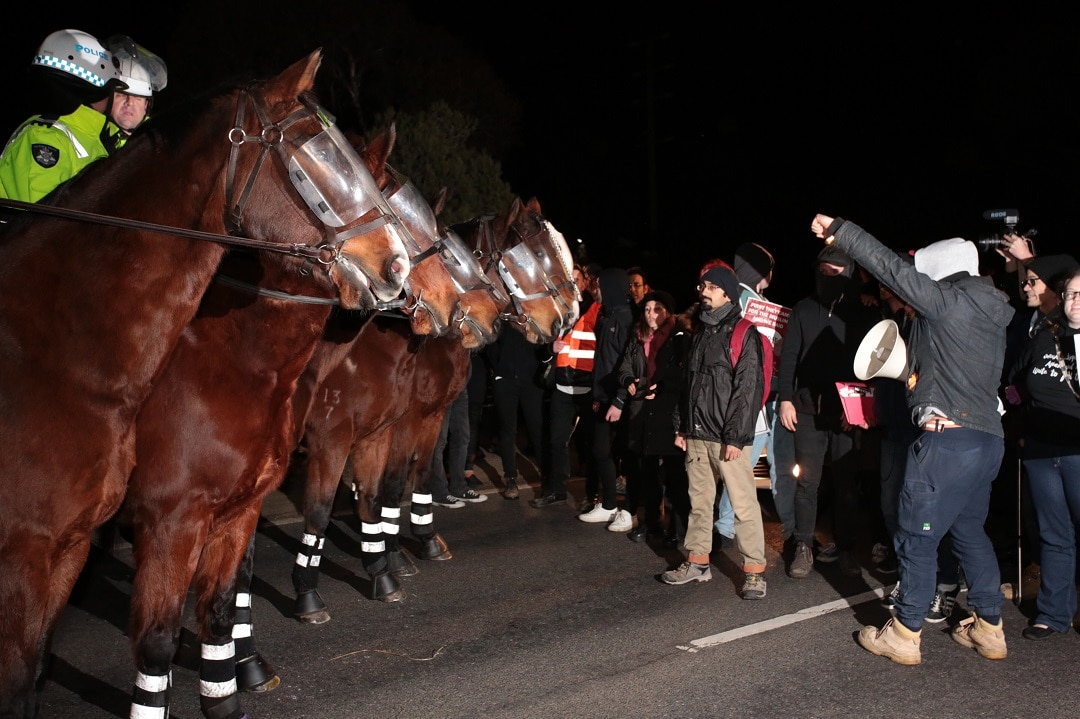 Anti-fascist protesters block the Hume highway.