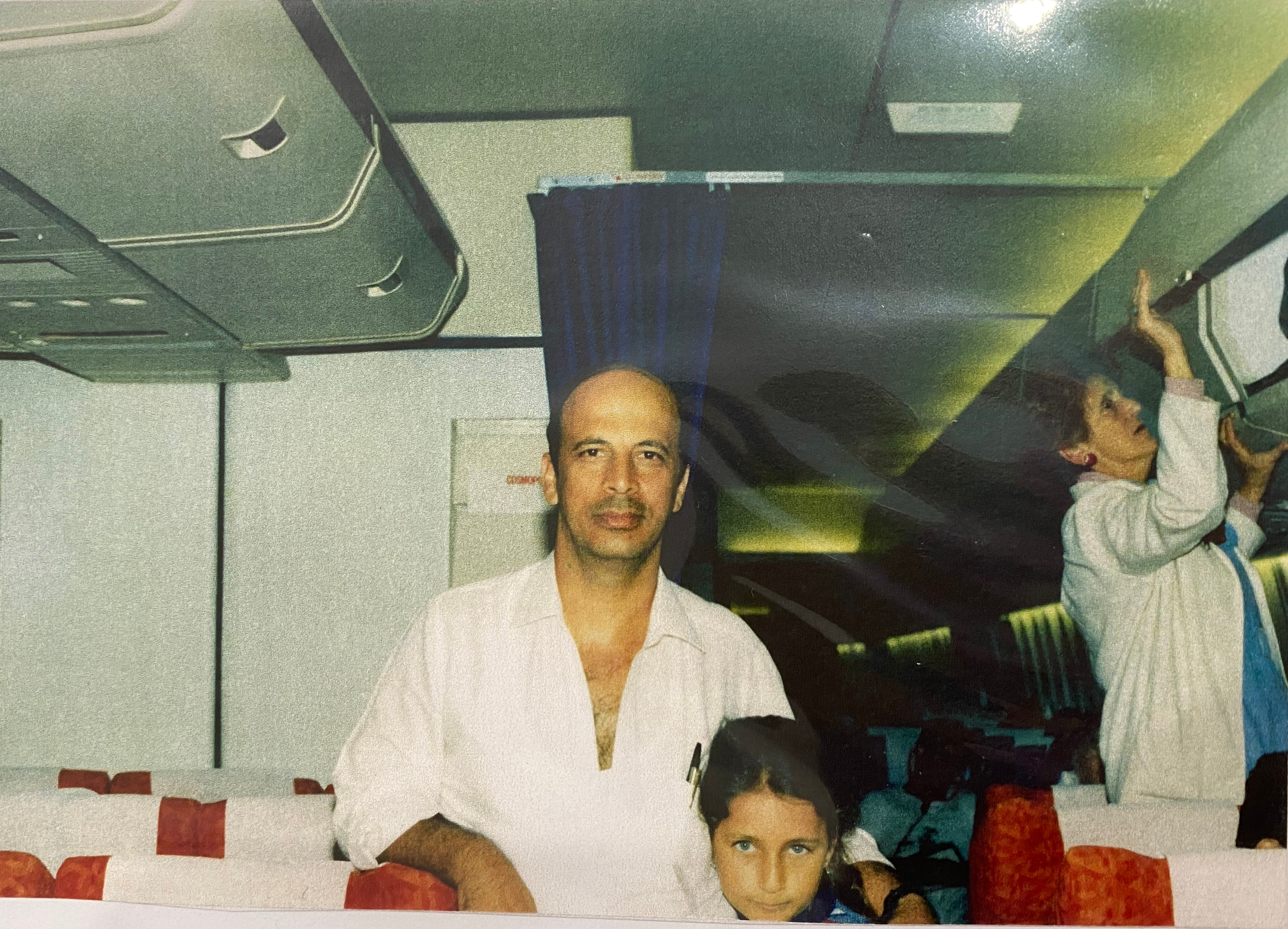 Ghania and her father on board the plane from Cyrus to Sydney in 1985.