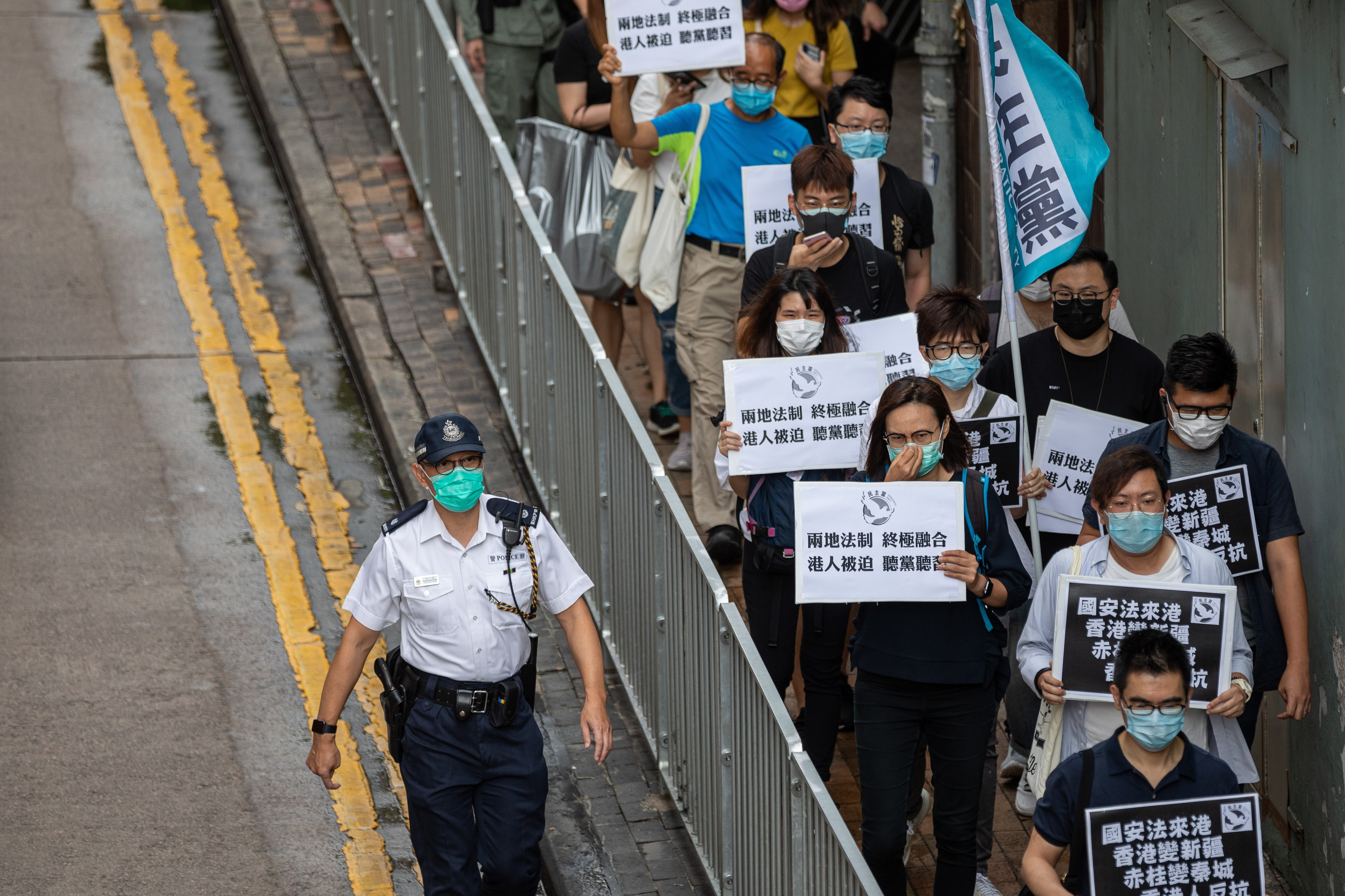 Pan-democrat lawmakers and activists make their way to Chinas Liaison Office during a rally against a security law in Hong Kong, China.