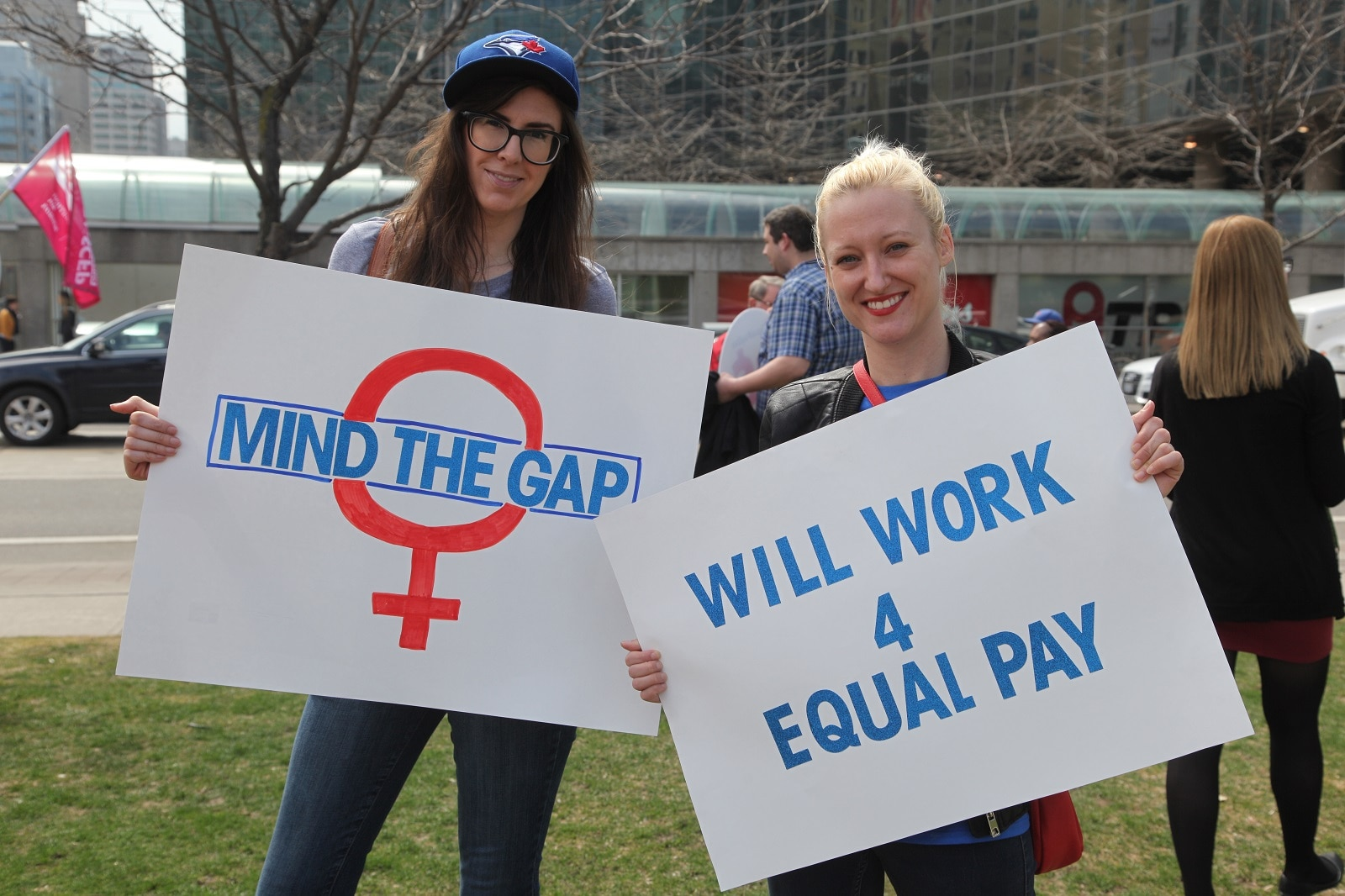 Women rally to demand equal pay for women in Toronto, Canada.