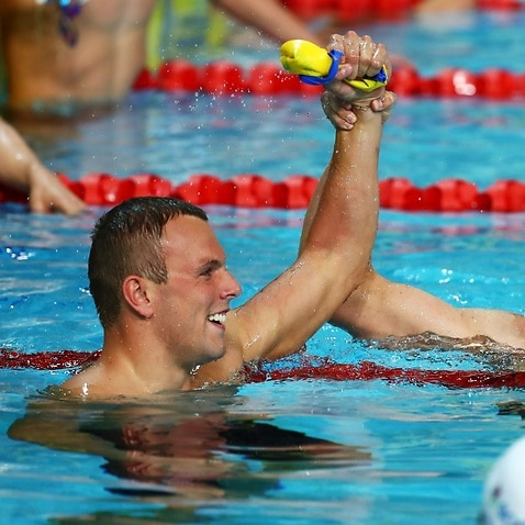Kyle Chalmers of Australia (L) and Mack Horton of Australia embrace following the Men's 200m Freestyle Final