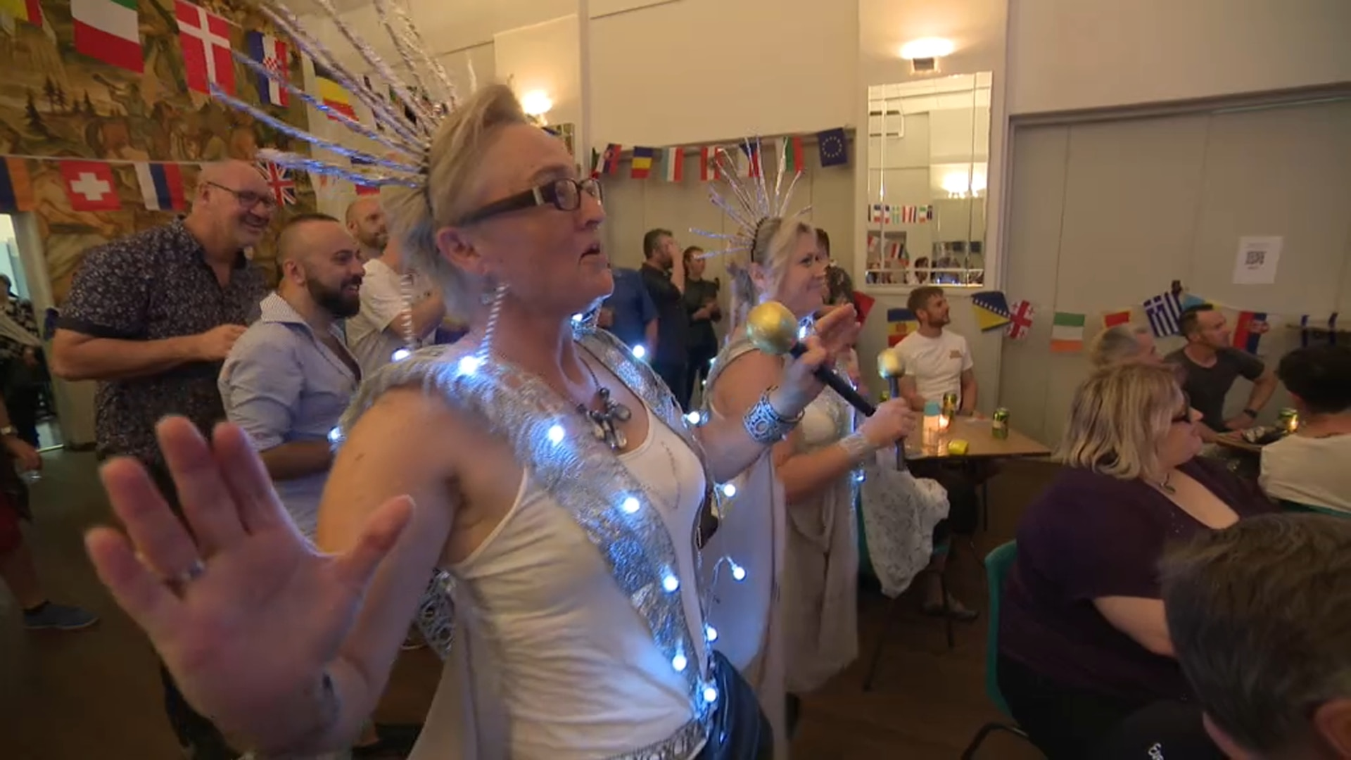 Eurovision fans dance to Kate Miller-Heidke's 'Zero Gravity' at a preview party in Sydney.