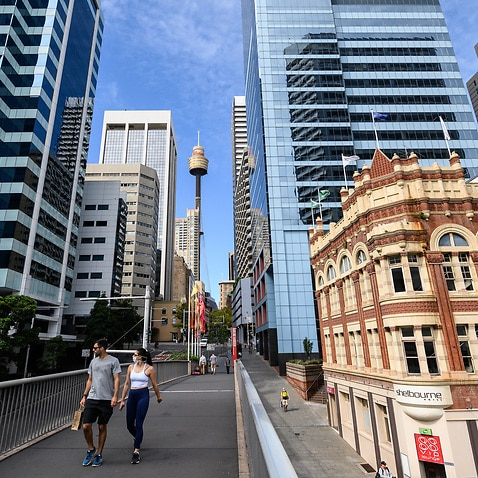 People walking in a quiet part of the CBD, in Sydney.