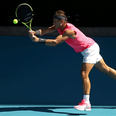 Rafael Nadal of Spain plays a backhand during an Australian Open practice session at Melbourne Park in Melbourne.