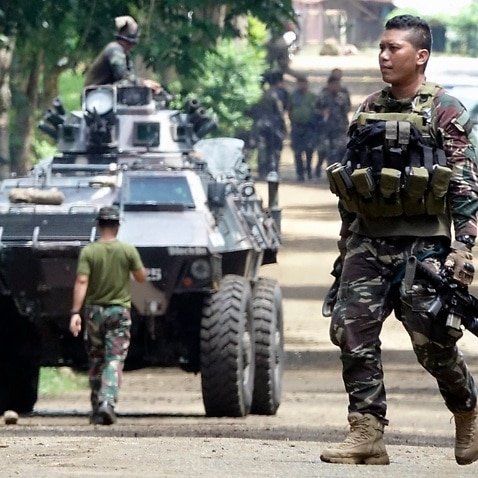 Filipino government troops prepare for deployment on the fifth day of fighting in Marawi city, Mindanao island, southern Philippines, 28 May 2017