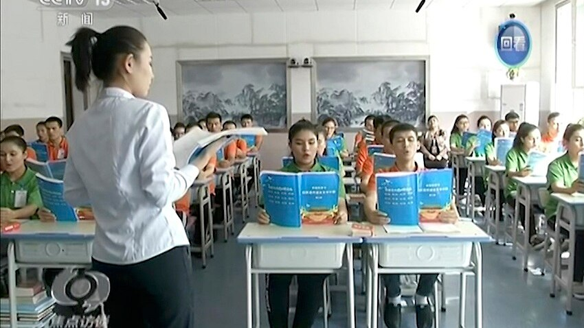 China let cameras in earlier this month to show off the education camps.