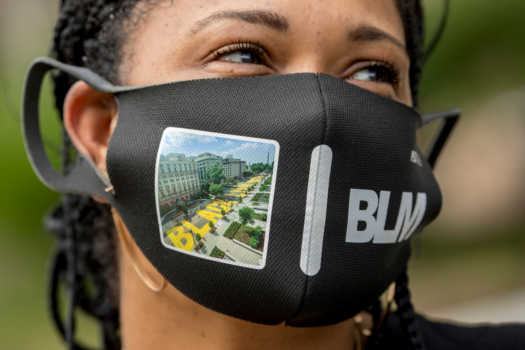 Shawna Jacobs wears a mask with a photograph of 16th Street Northwest renamed Black Lives Matter Plaza in Washington.