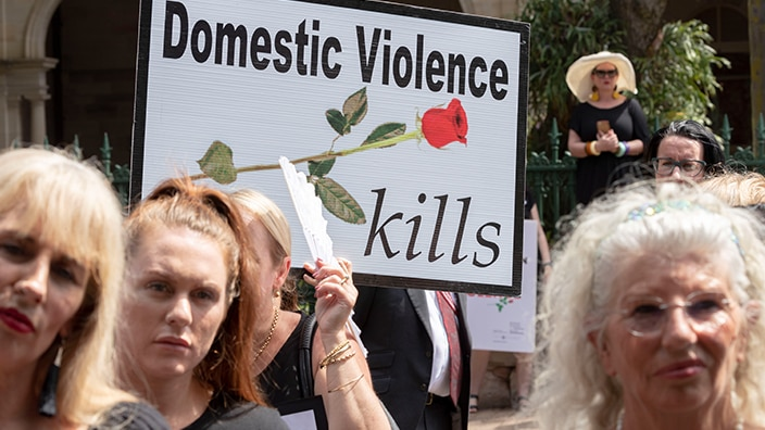 Women rally against family violence in Queensland.