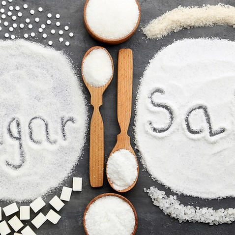 Inscription Sugar and Salt on grey wooden table