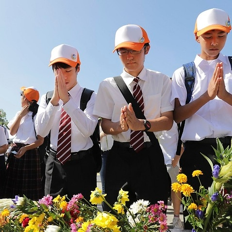 Students offer prayers for the victims of Hiroshima at Peace Memorial Park on the 72th anniversary.