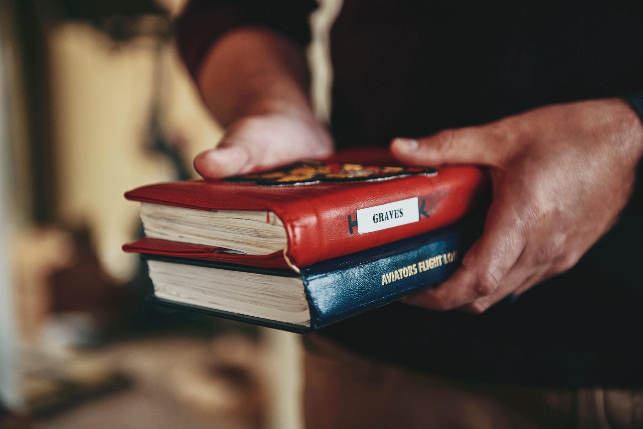 Lieutenant Graves with Navy flight log books.
