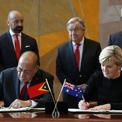 East Timorese minister Agio Pereira and Australian foreign minister Julie Bishop sign the treaty at the United Nations headquarters.