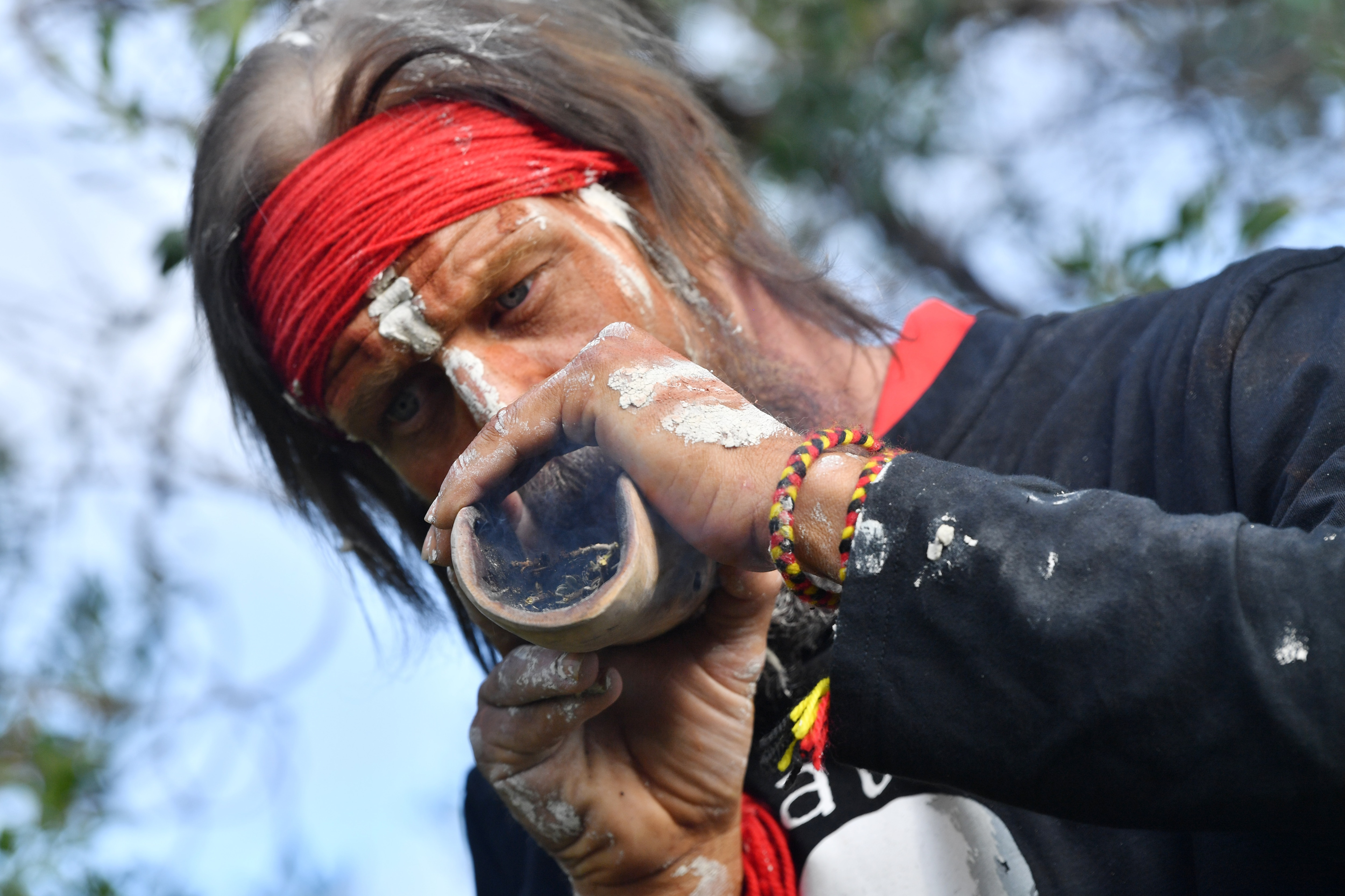 Elder Yuandanarra is seen during a burial ceremony to return of Kaurna Old People at Kingston Park, Adelaide. Thursday.