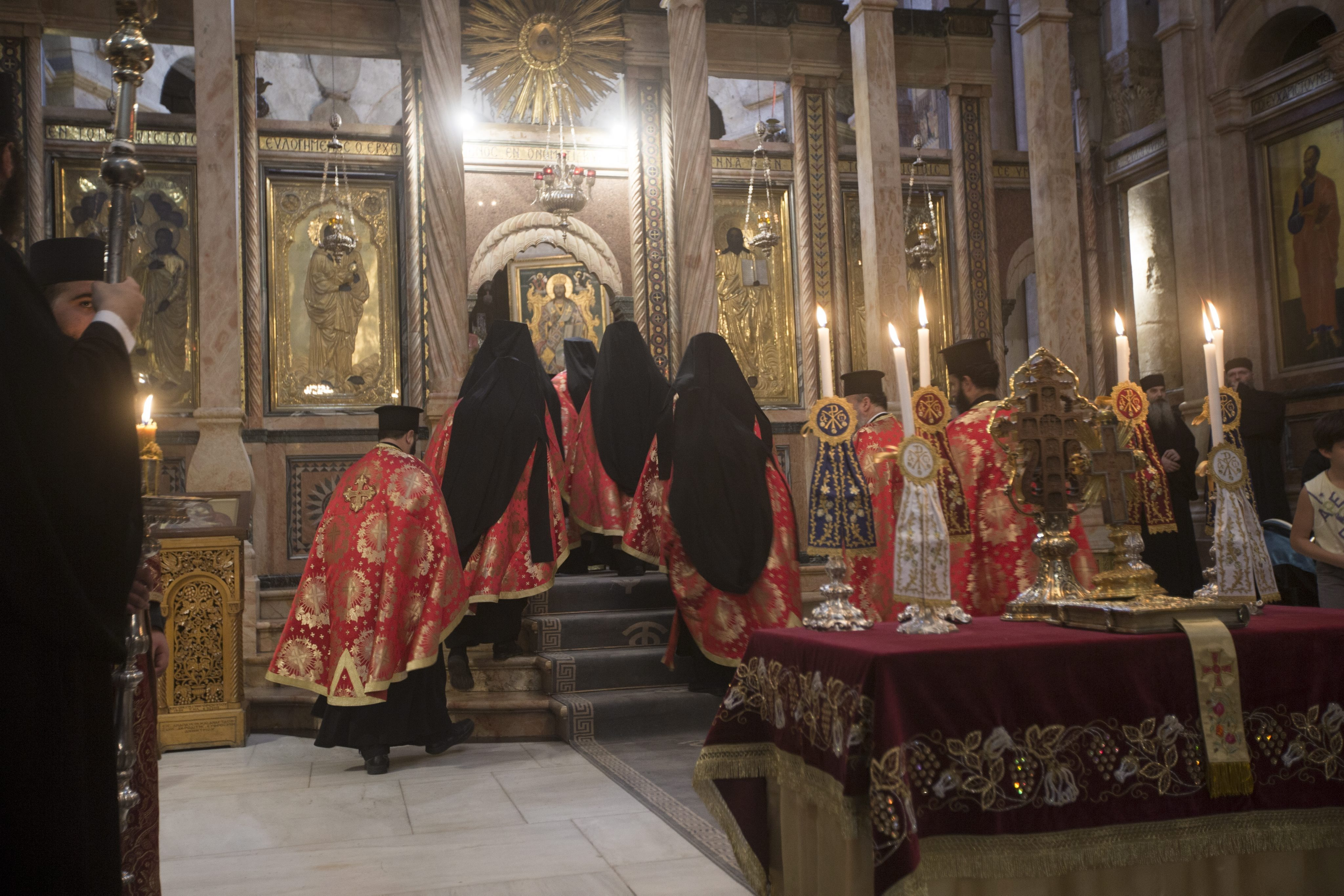 Greeks orthodox clergy during a Mass at the Church of the Holy Sepulchre, in the old city of Jerusalem, 28 October 2016. Archaeologist have for the first time in centuries exposed the original surface of what's believed to be the traditionally burial plac