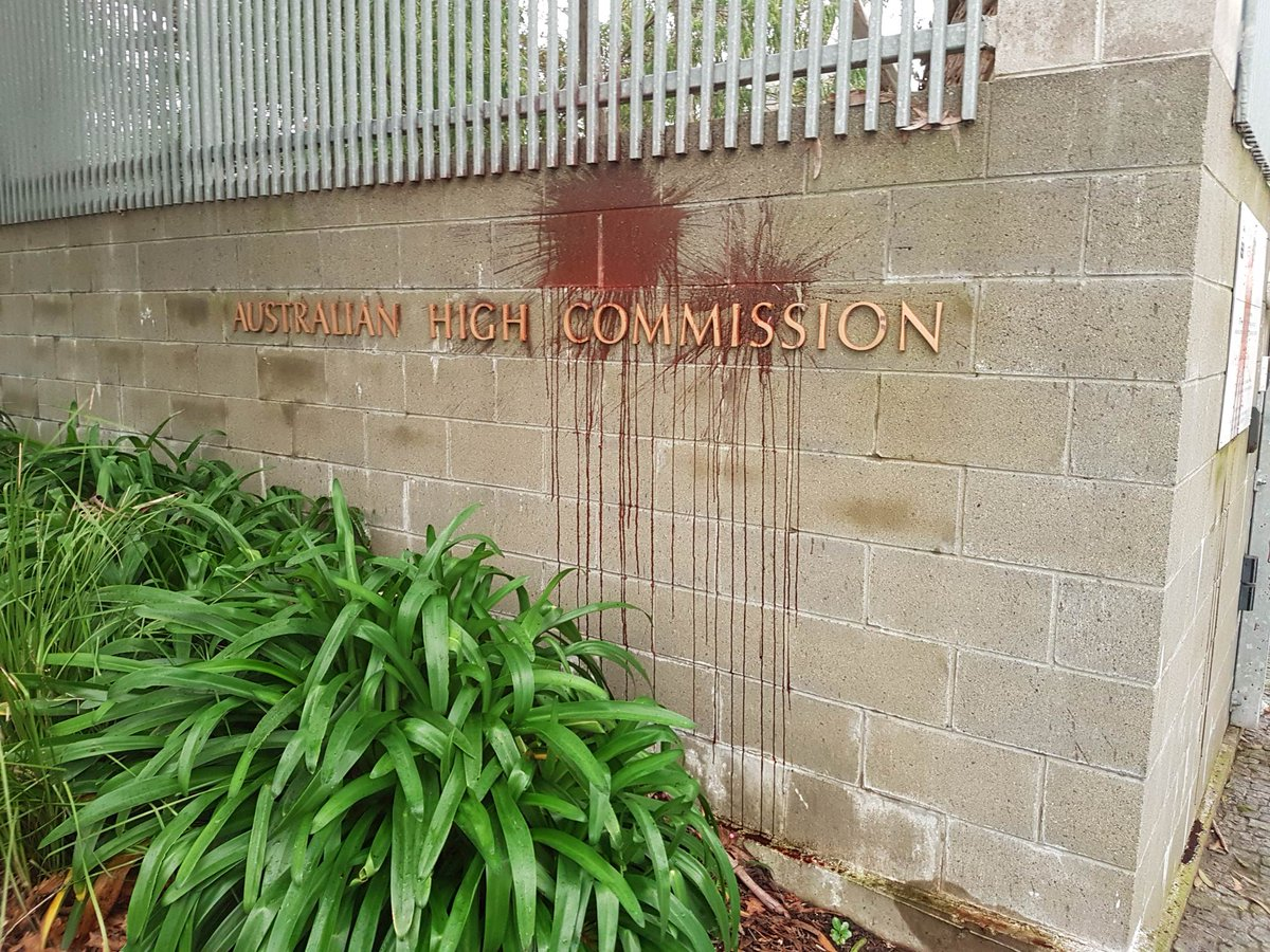 Australian High Commission in Wellington targeted by a red substance after the death of a refugee on Manus Island's detention centre.