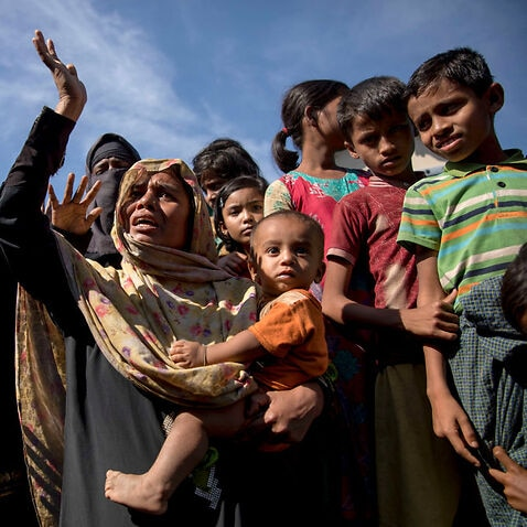 Myanmar Rohingya refugee women shout slogans as they protest