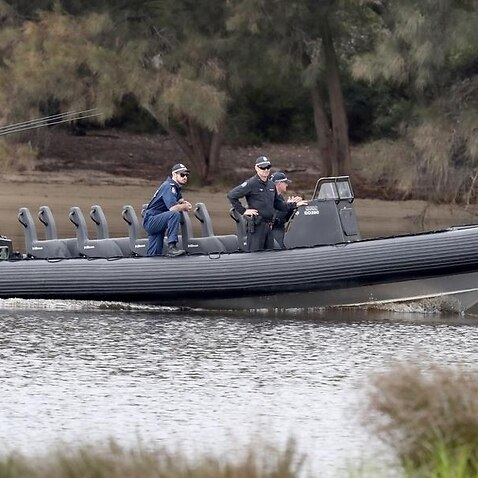 A police boat returns to the Maylands boat ramp