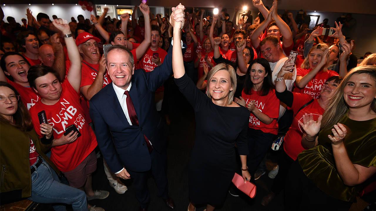 Opposition leader Bill Shorten celebrates with Susan Lamb.
