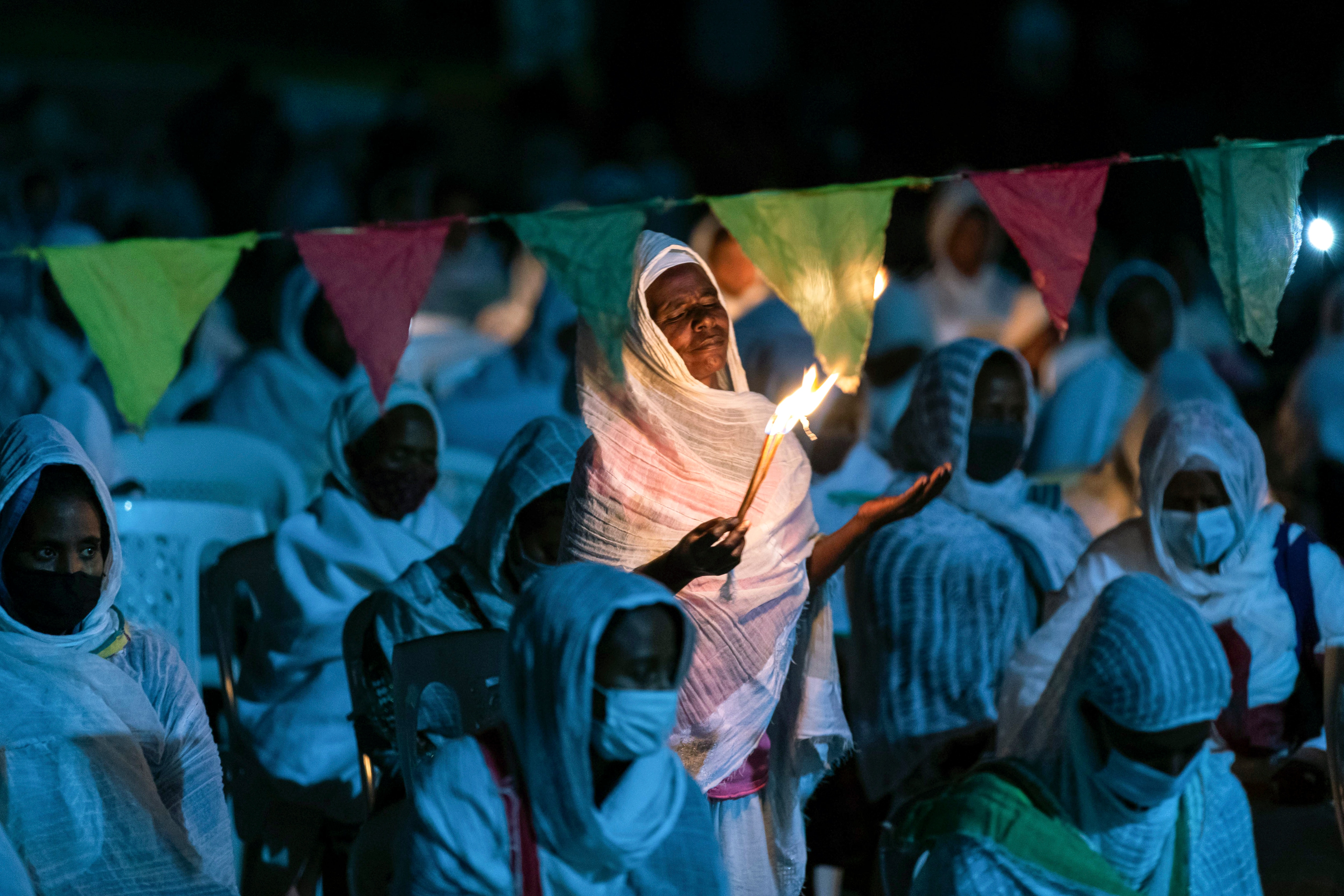 Ethiopian Orthodox Christians light candles and pray for peace during a church service in the Ethiopian capital Addis Ababa.