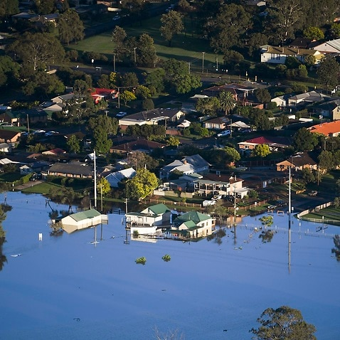 Buildings are partially submerged in a floodwater in the Windsor area, northwest of Sydney, Australia, Wednesday, March 24, 2021.
