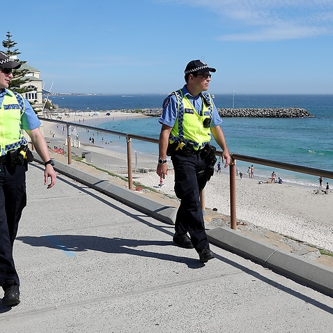 Police officers are seen patrolling Cottesloe Beach in Perth.
