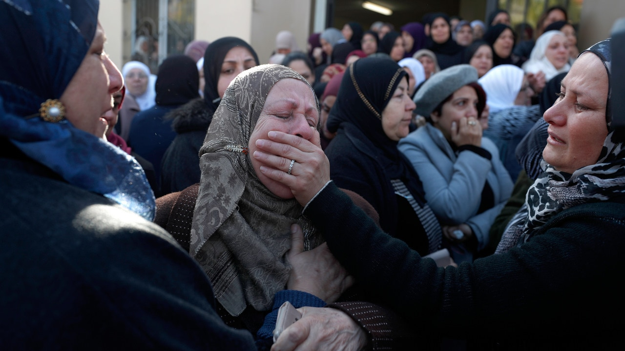 Mourners attend the funeral of Aya Maasarwe at her hometown of Baqa al-Gharbiya.