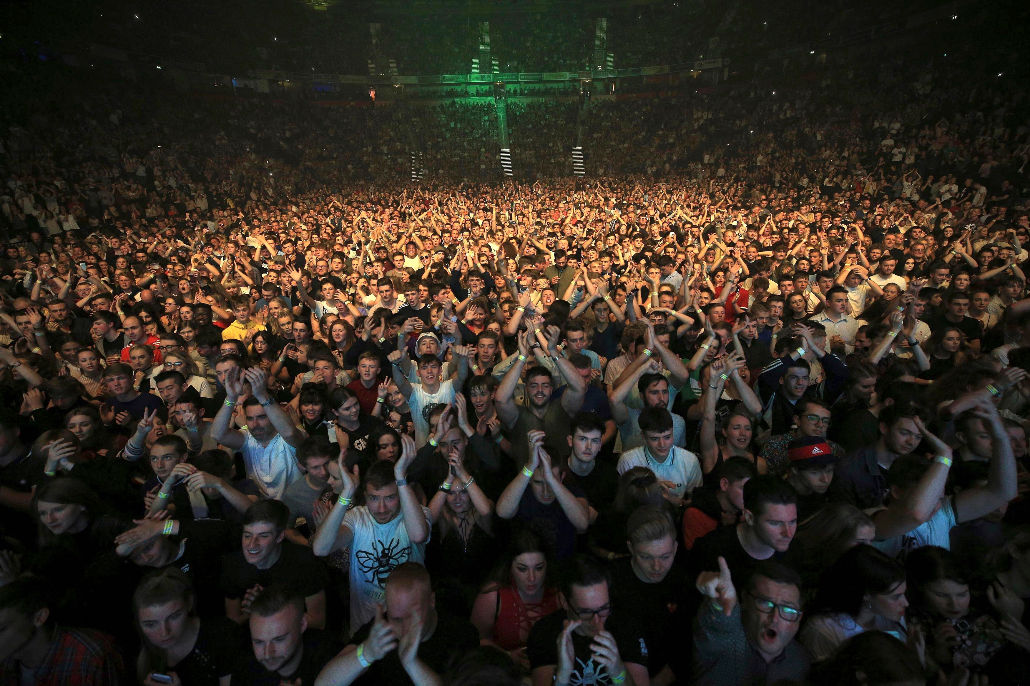 The crowd cheer during the 'We Are Manchester' benefit show following the re-opening of the Manchester Arena in 2017.