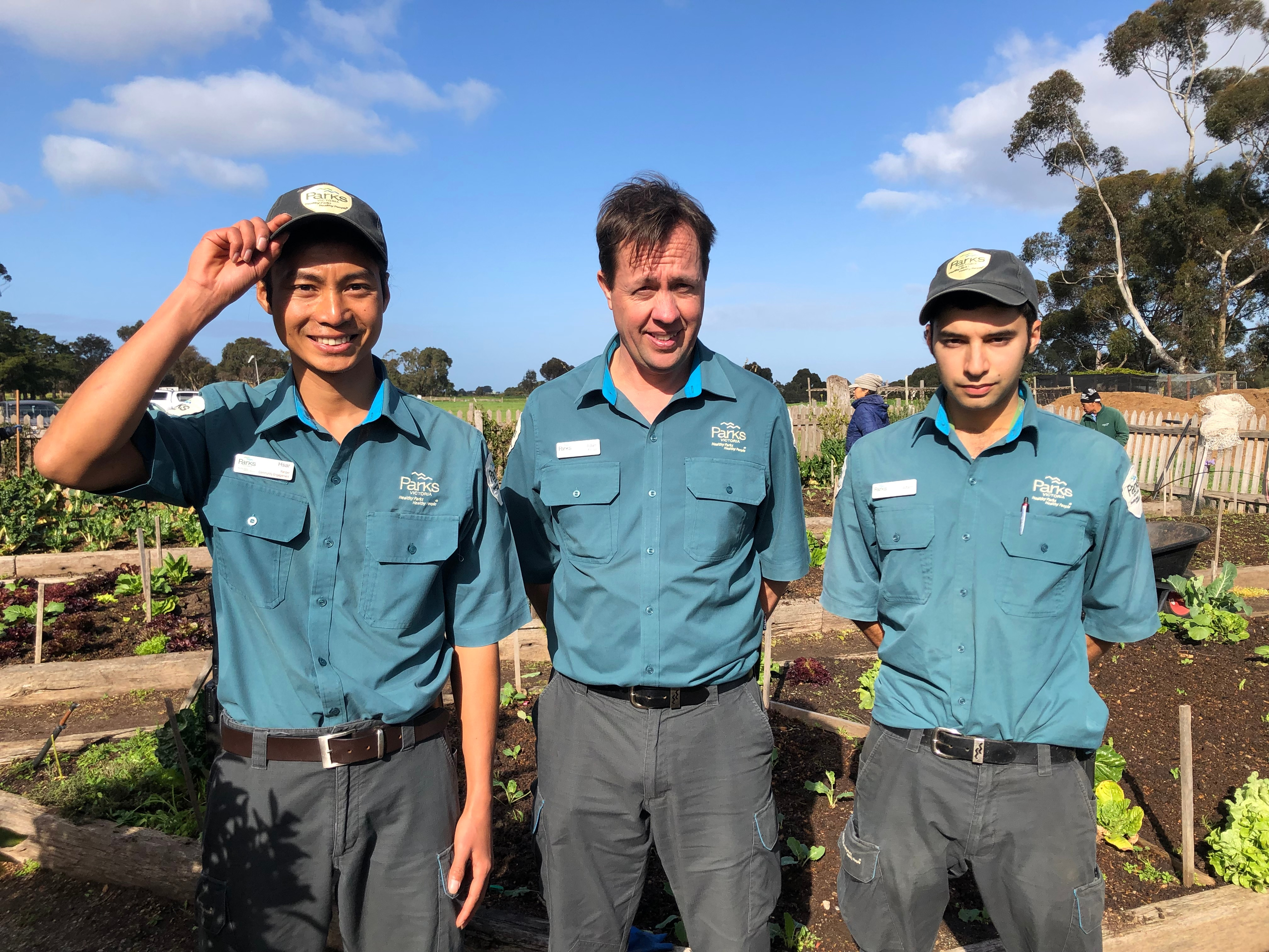 Hsar Ju, left, with his Parks Victoria colleagues.