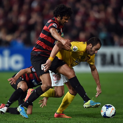 Wanderers skipper Nikolai Topor-Stanley (left) tangles with Alberto Gilardino in last year's heated ACL clash against Guangzhou Evergrande (AAP)