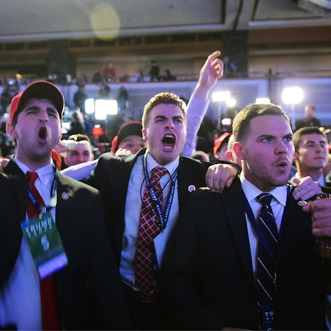 Supporters of Republican presidential nominee Donald Trump reacts to early results during election night at the New York Hilton Midtown in New York on November 8, 2016.