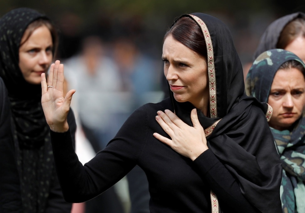 New Zealand Prime Minister Jacinda Ardern, center, waves as she leaves Friday prayers at Hagley Park in Christchurch.