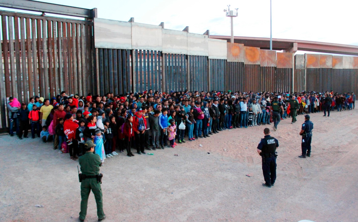 This May 29, 2019 file photo released by U.S. Customs and Border Protection (CBP) shows some of 1,036 migrants who crossed the US-Mexico border in El Paso