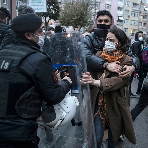Turkish police block women during a protest against Turkey's withdraw decision from Istanbul Convention in Istanbul, Turkey on 20 March 2021.