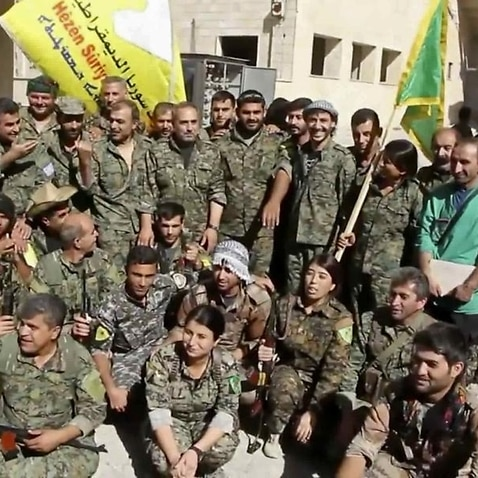 Syrian Democratic Force soldiers celebrate securing Raqqa.