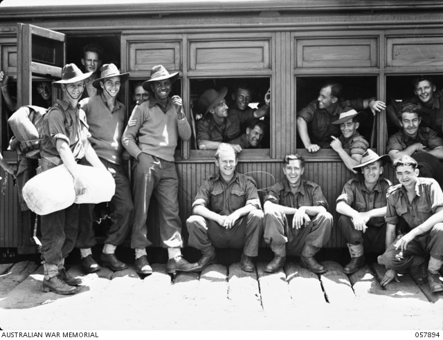 Reg Saunders with members of the 2/7th Battalion in 1943.