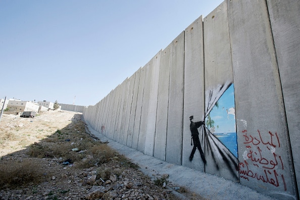 Banksy art on Israel's highly controversial West Bank barrier in Abu Dis in 2005. Banksy has made a name for himself with provoc