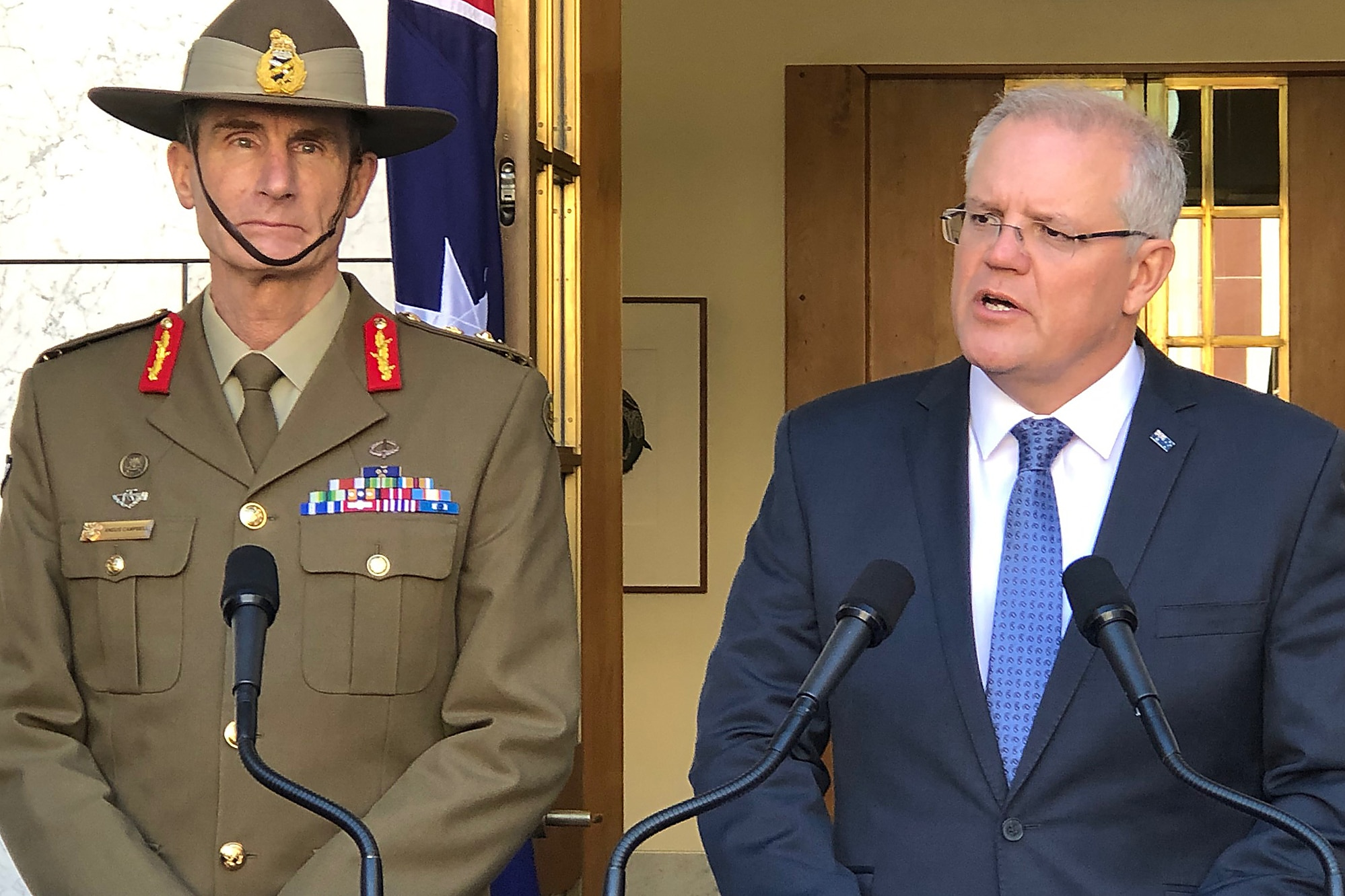 Prime Minister Scott Morrison (right) and Defence Force chief Angus Campbell announce Australia will send troops to the Strait of Hormuz.