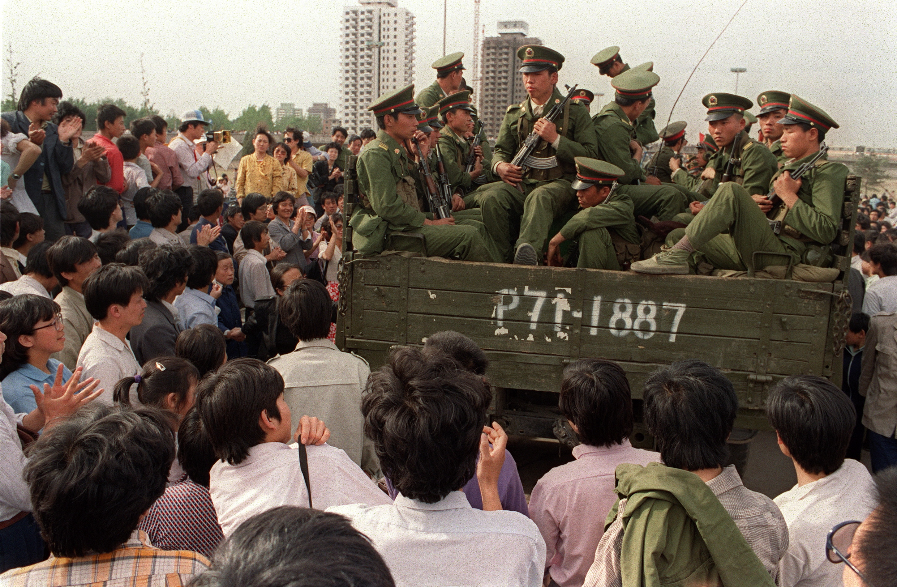 Pro-democracy demonstrators surround a truck filled of People's Liberation Army soldiers 20 May 1989.