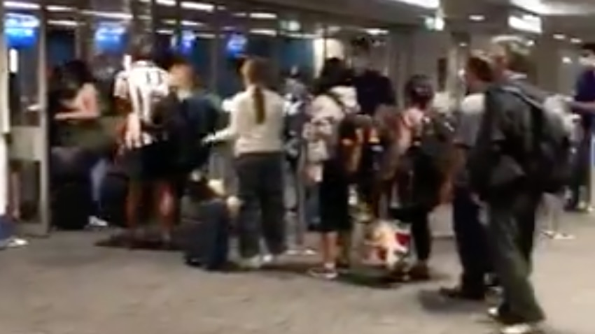 Anger after officials fail to enforce social distancing measures at Sydney Airport – SBS News