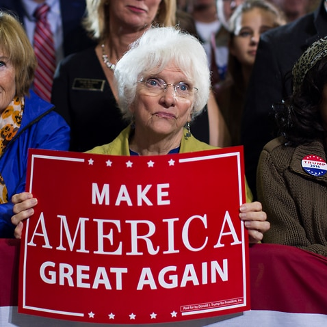 Supporters of Republican presidential candidate Donald Trump watch him speak during a campaign rally, Monday, Oct. 31, 2016, in Grand Rapids, Mich.