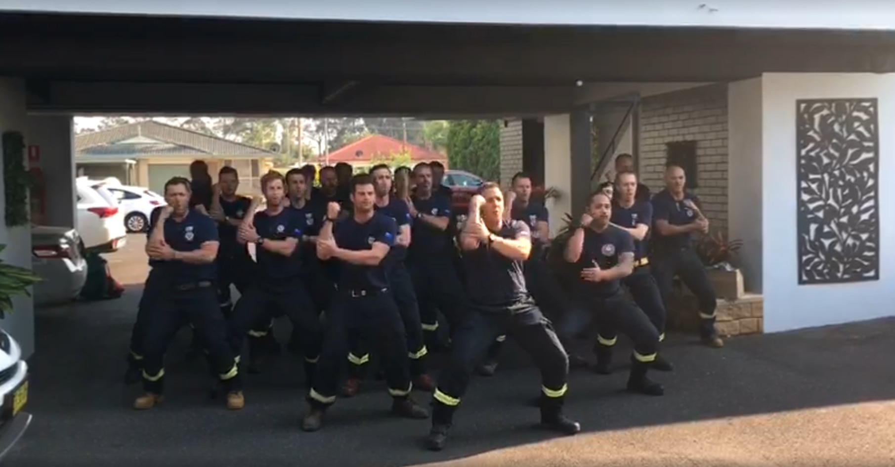 The New Zealand fire crew perform a traditional haka after spending three weeks fighting fires in NSW.