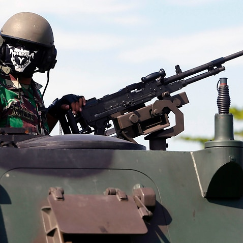 An Indonesian military officer operates an armoured vehicle
