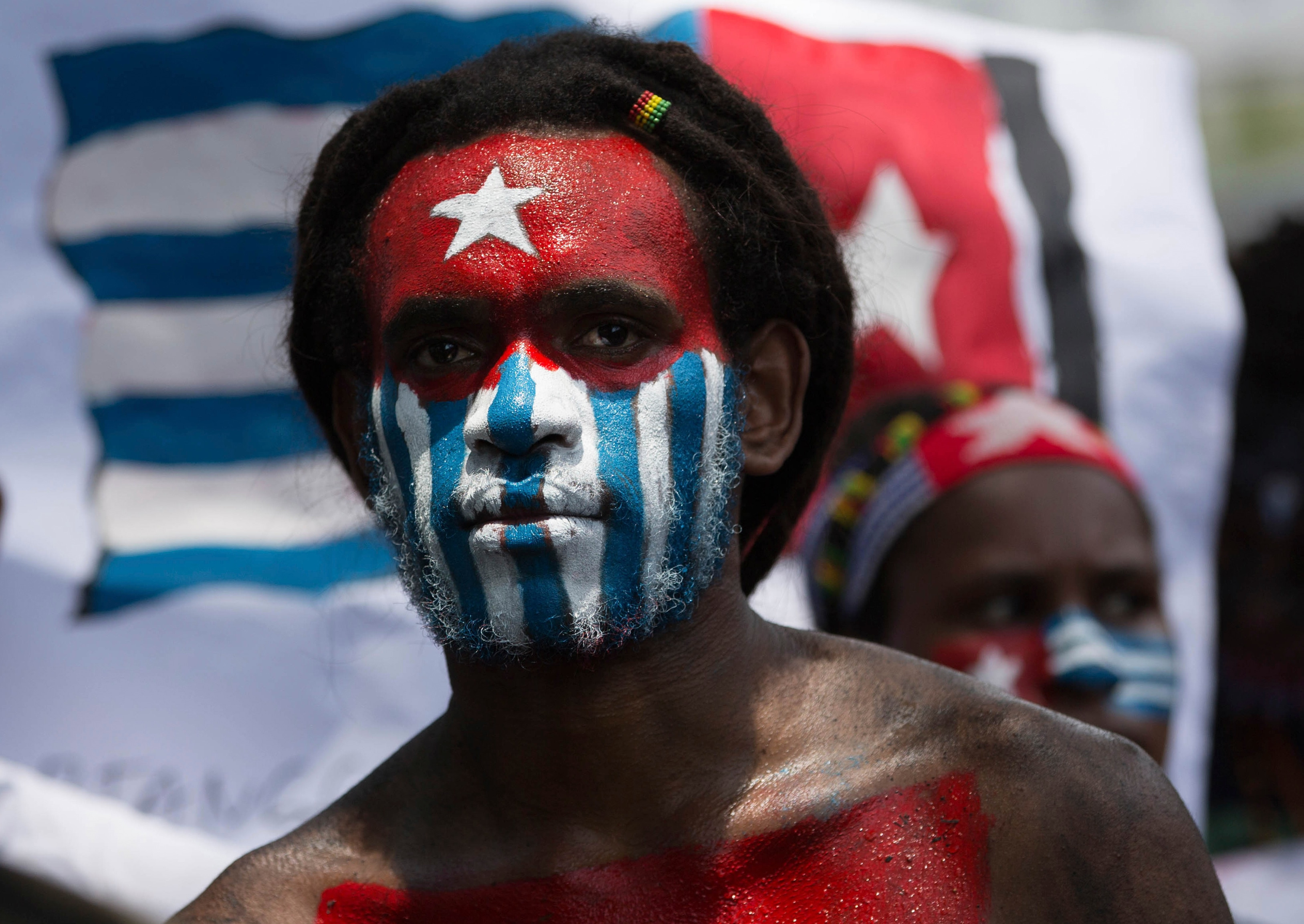 A Papuan student, with his body and face painted with the colors of the banned separatist 'Morning Star' flag.