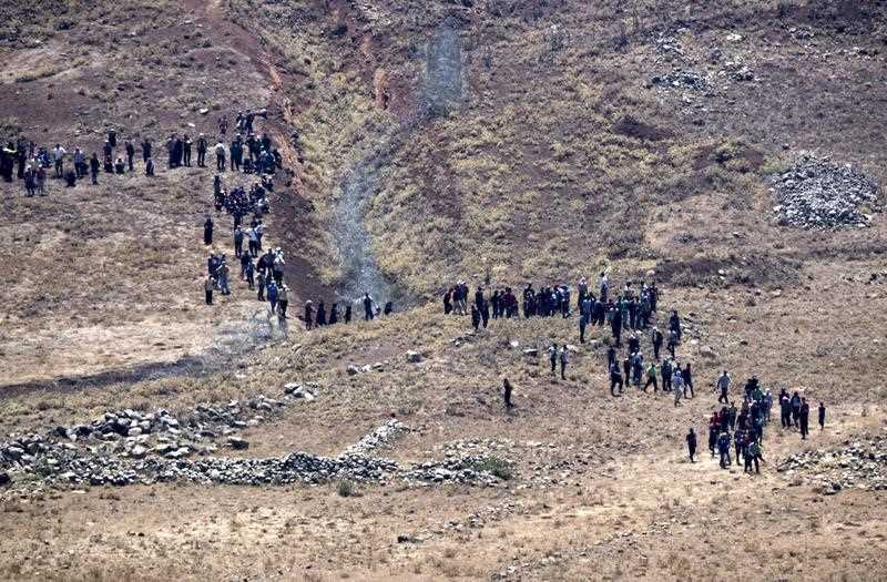 Syrian Refugees march toward the Israeli Security fence demanding help.