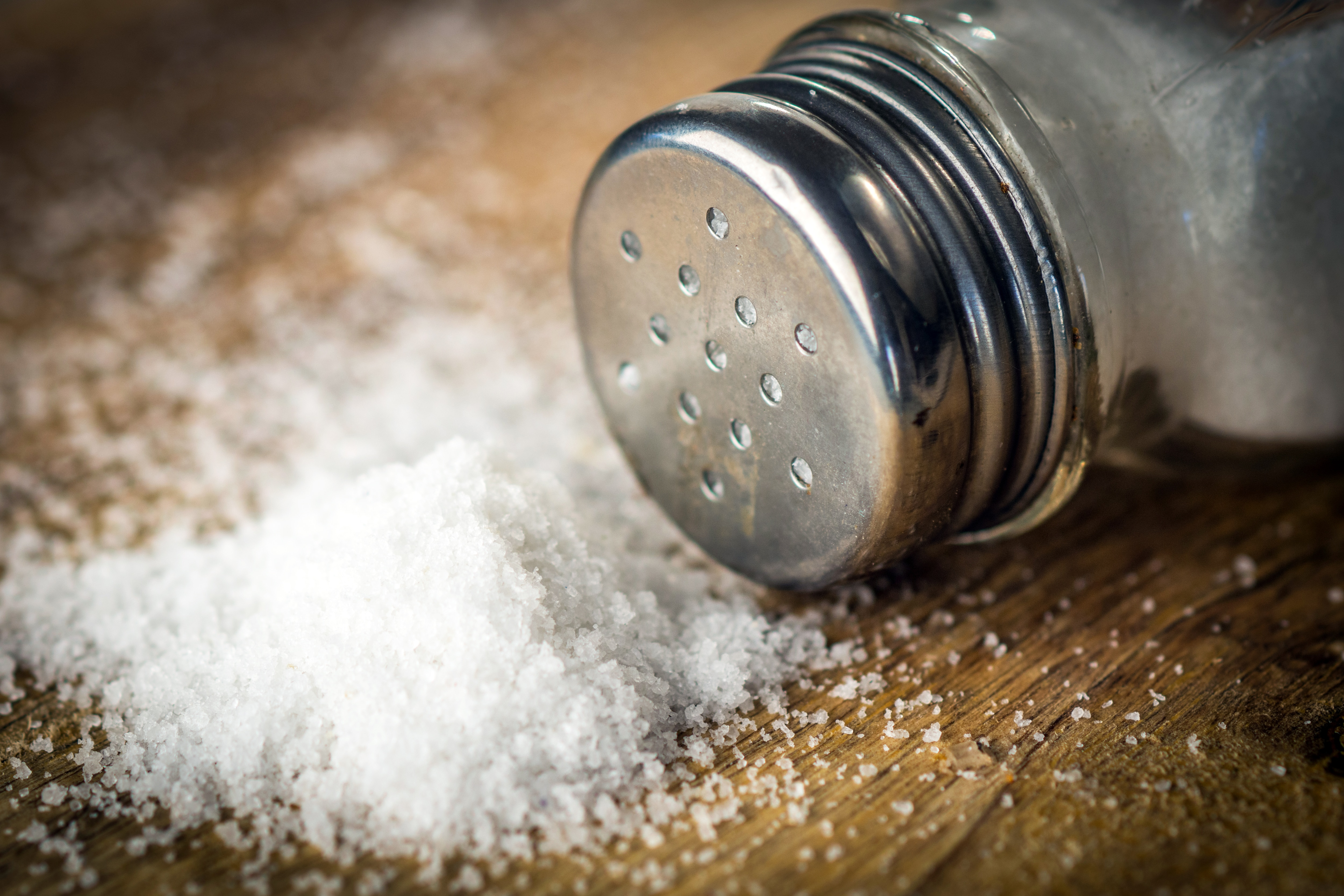 Salt on wooden background